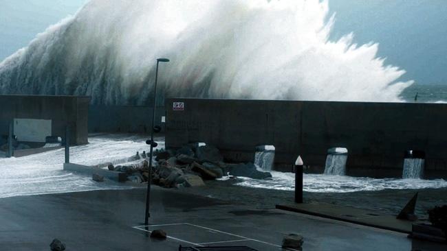 Beach Wave Crashing Against Seawall